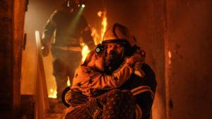 Fireman saving a girl from fire