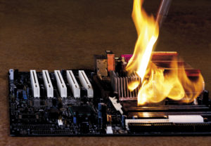 An electronic circuit on fire needing PCB heat dissipation techniques