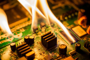 Picture of a printed circuit board erupting into flames