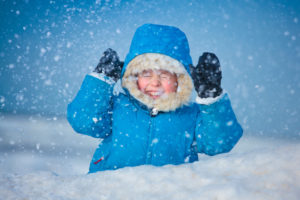 Picture of child with winter coat in the snow