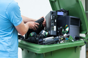 Man discarding electronics