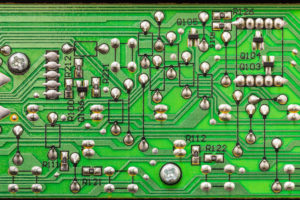 Picture of a circuit board with green solder mask