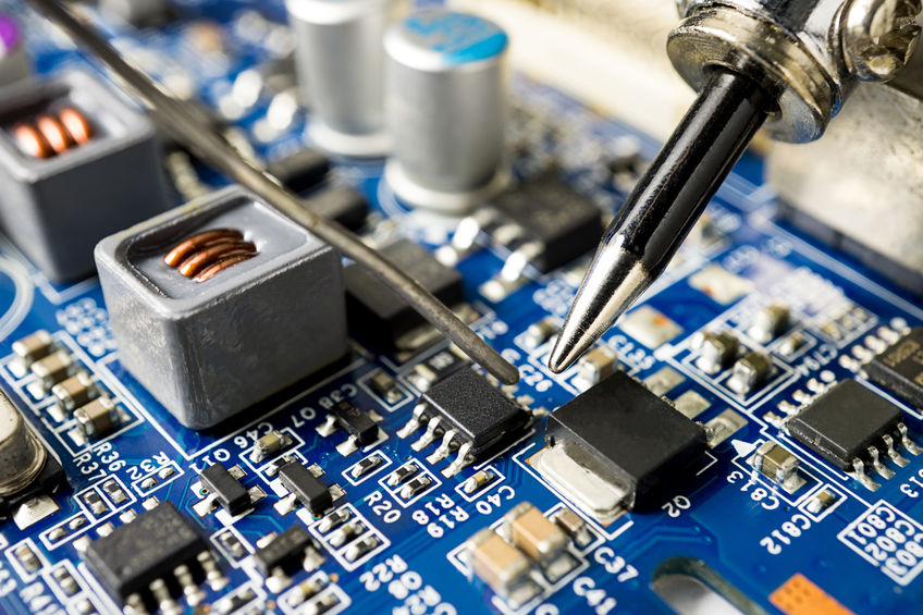 Repairing a microchip with a soldering iron and utilizing proper solder bridging avoidance techniques