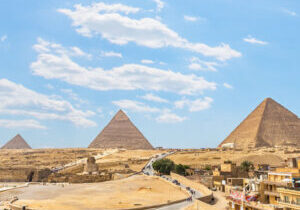Pyramids and Sphinx on Giza plateau in desert of Egypt, view from above